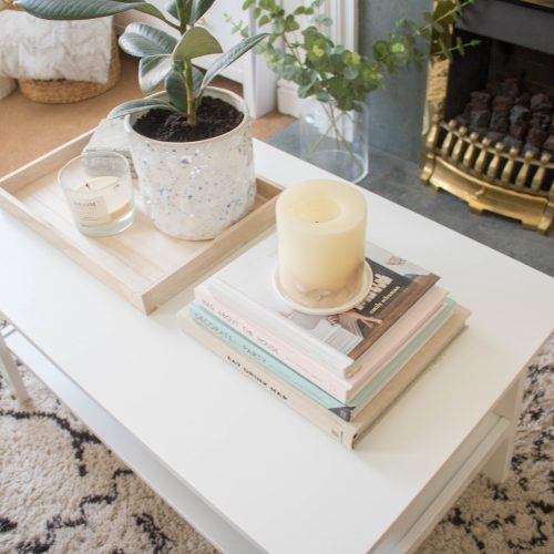 an edited lifestyle interiors neutral coffee table styling