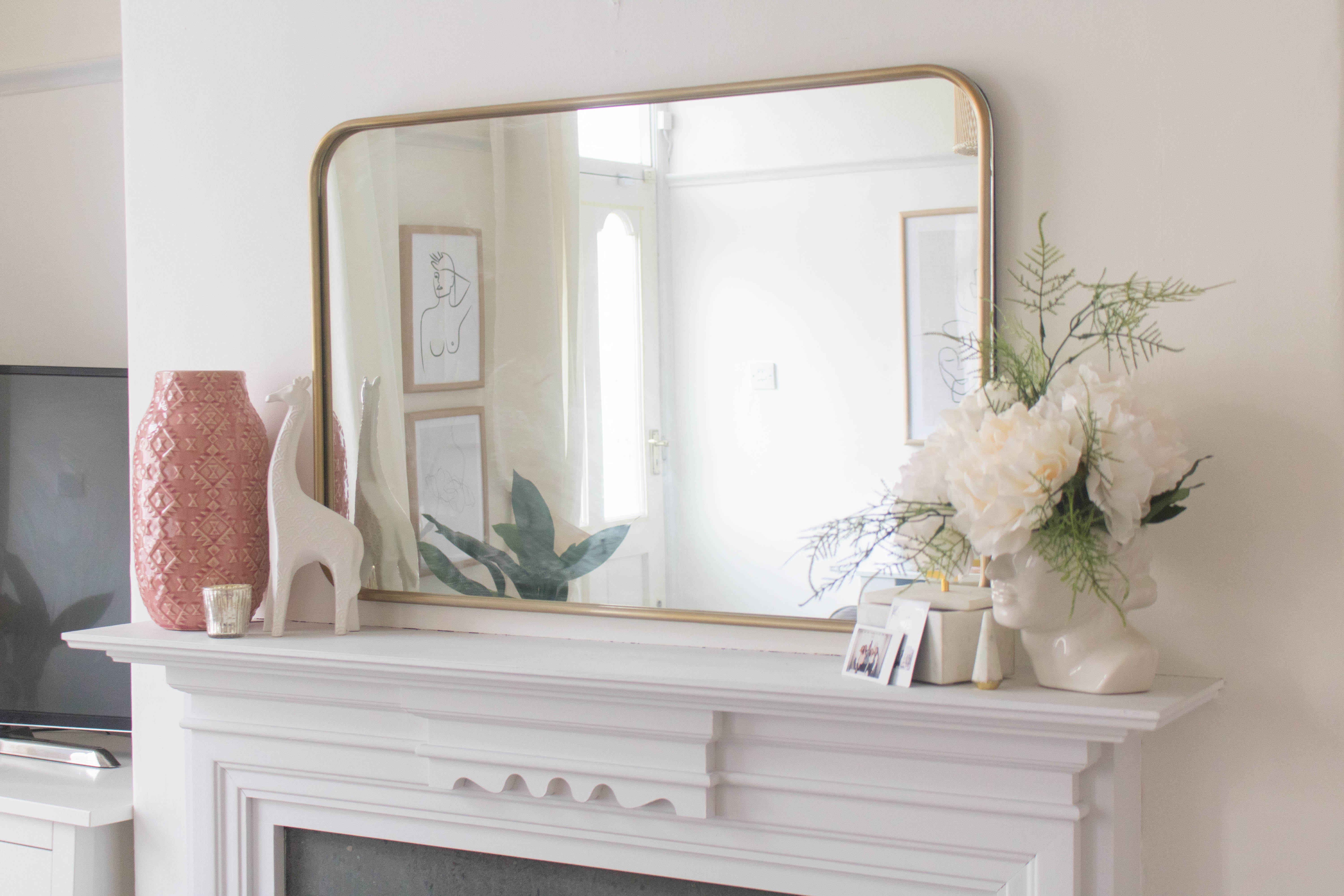 an edited lifestyle styling a fireplace