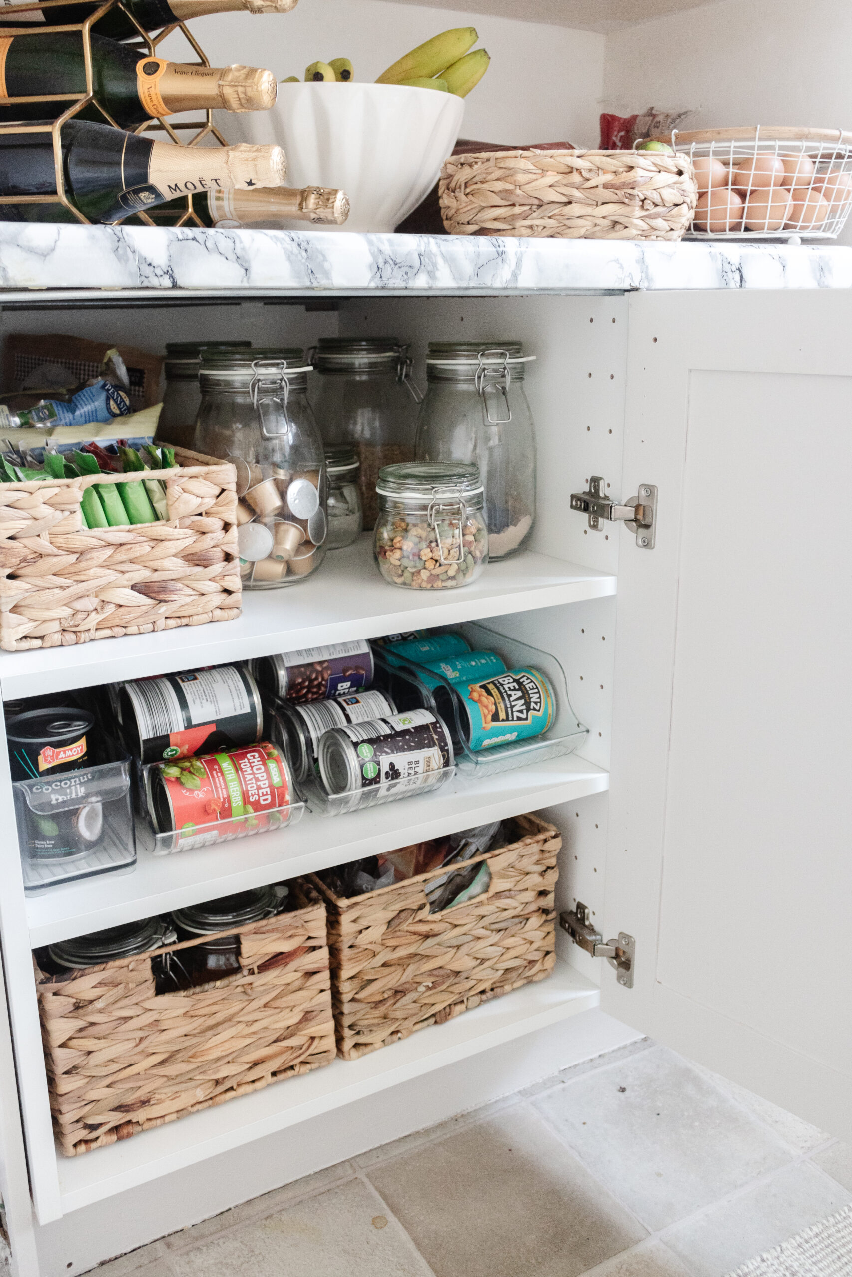 an edited lifestyle interiors organise my kitchen cabinets